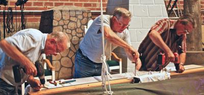 Volunteers perform restoration work