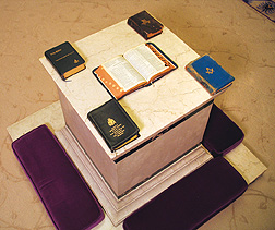 Collage of Bibles with Masonic symbols on cover