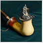 Thumbnail of one of Pike's favorite pipes, which has a silver statuette of Germania