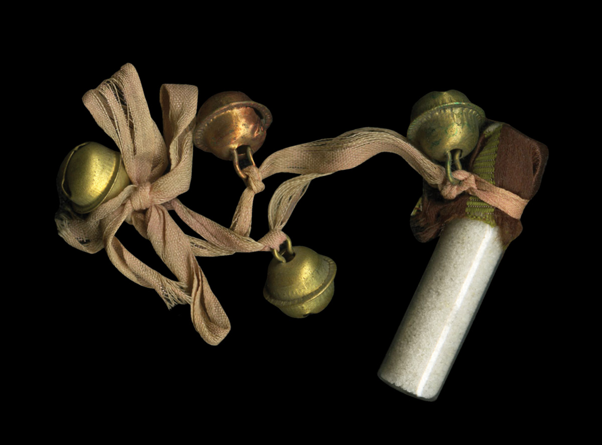 This vial of salt from the House of the Temple collection has a ribbon with four small bells attached to it.