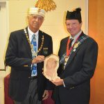Two Scottish Rite Masons hold a block of cedar bearing the seal of the Valley of Panama City, FL