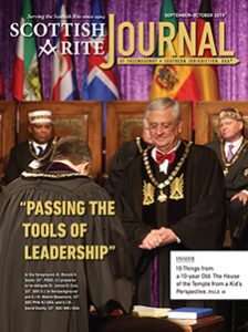 "Cover of the September-October 2019 Scottish Rite Journal, with the subtitle ""Passing the Tools of Leadership;"" In the foreground, Ill. Ronald A. Seale, 33°, PSGC, (r.) prepares to re-obligate Ill. James D. Cole, 33°, SGC (l.). In the background are (l.) Ill. Melvin Bazemore, 33°, SGC PHA NJ USA, and (r.) Ill. David Glattly, 33°, SGC NMJ USA."