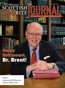 """Photo of Dr. S. Brent Morris, 33°, Grand Cross, with the caption, """"Happy Retirement, Br. Brent!"""""""
